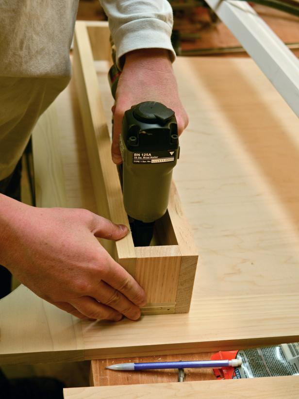 "When making the front shelf to your custom range hood, tack into place with finishing nailer. Secure back of box to range hood's front panel with 1-1/4"" wood screws."