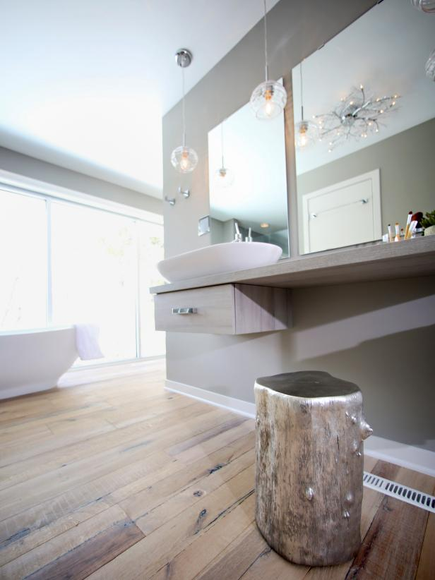 Gray Bathroom With Silver Tree Stump and Vessel Sink
