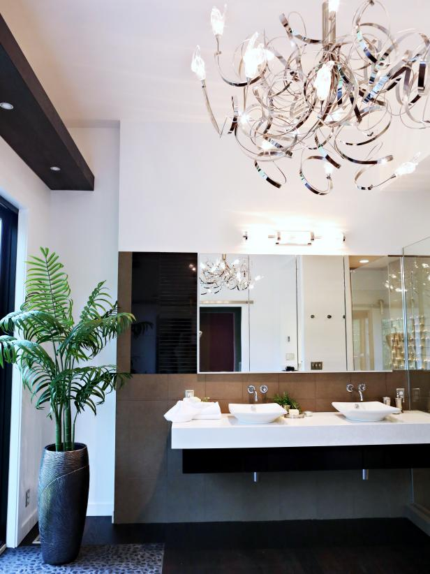 Contemporary Bathroom With a Double Vanity and Metal Chandelier