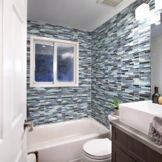 Contemporary Bathroom With Glass Tile Walls