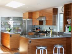 Brown and Gray Contemporary Kitchen With Stainless Countertops