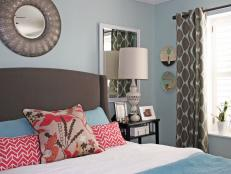 An Eclectic Bedroom With Blue Walls and Mix and Matched Patterns