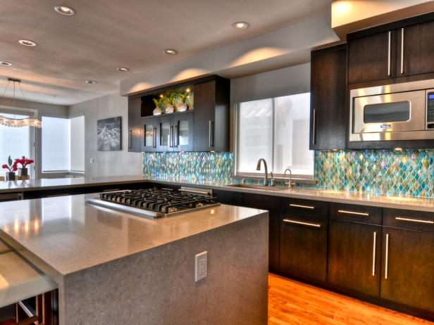 Contemporary Kitchen With Waterfall Island & Dark Stained Wood Cabinets