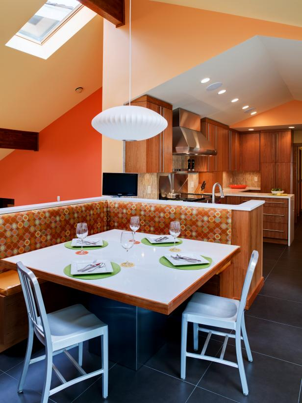 Yellow & Orange Eat-In Kitchen With Dotted Banquette, White Pendant