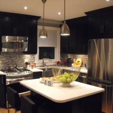 Modern Black And White Kitchen With Stainless Steel Appliances