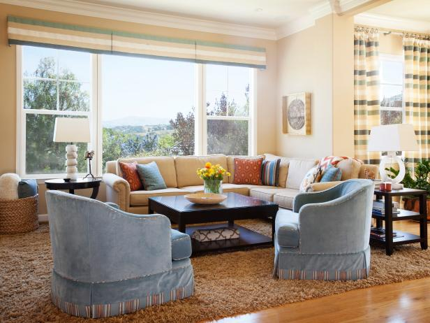 Transitional Living Room With Blue Armchairs and Large Window