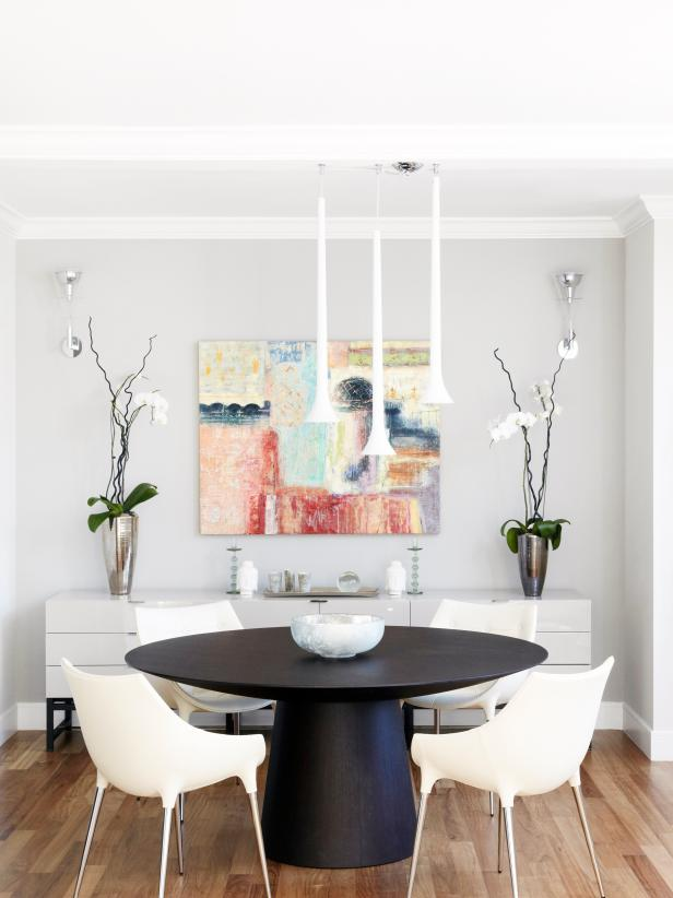 Modern dining room with round black table