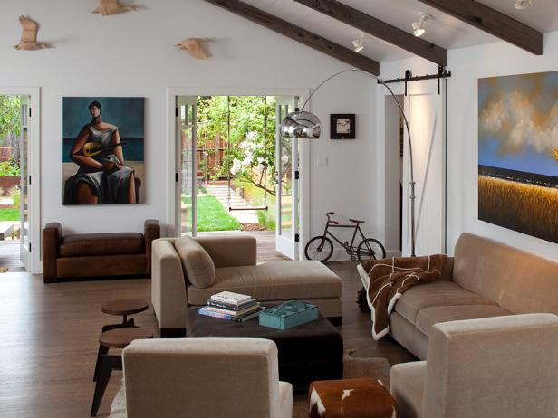 Large Modern Great Room With Taupe Furniture and Funky Artwork