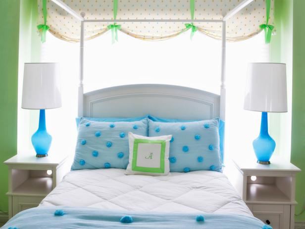 Green Eclectic Kid's Room With Blue Lamps and Bed Linens