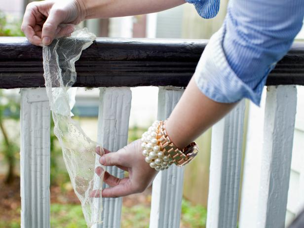 Remove cheesecloth from bucket, then drape over a bannister, fence or door to properly dry.