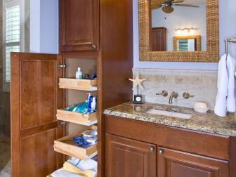 Coastal Bathroom With Tall Storage Cabinet
