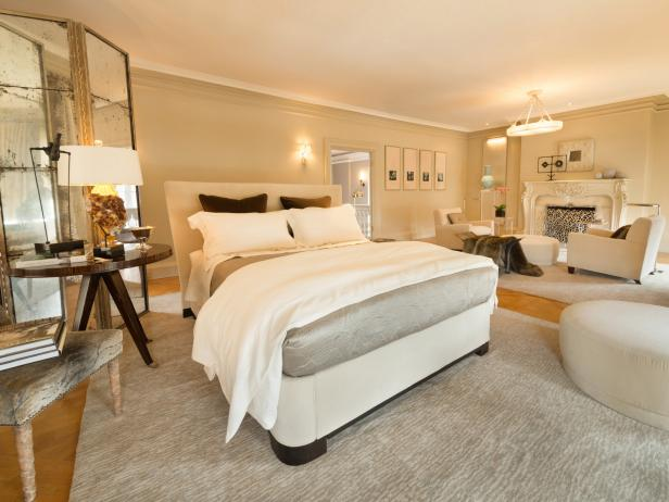 White Master Bedroom With Sitting Area and Fireplace