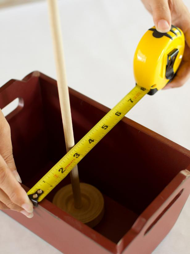 Place the tread wheel and dowel in the center of the serving container and measure the container's width.