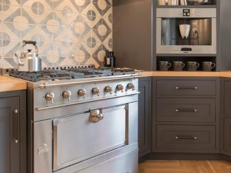Gray and White Chef's Kitchen With Dot Backsplash