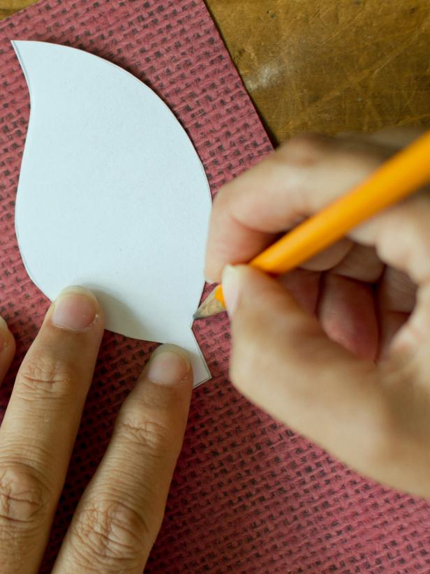 Use a pencil to trace several paper leaves on a variety of double-sided, patterned scrapbook papers. The double sided paper will ensure that your Fall centerpiece will look great from any angle.