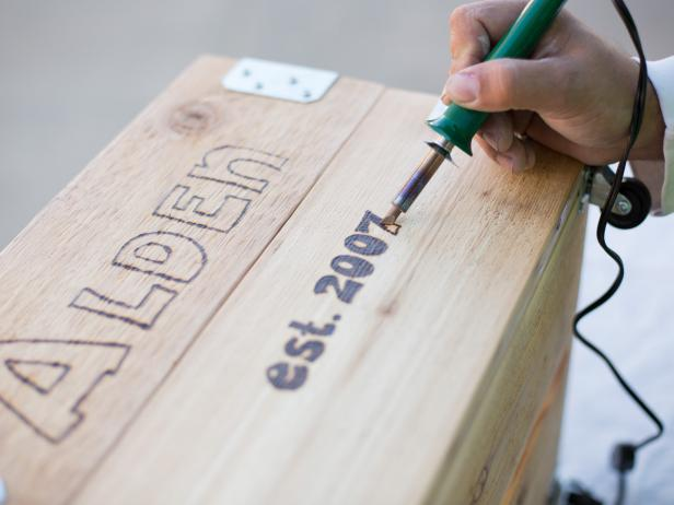 Fill In Letters on Crate With Wood-Burning Tool