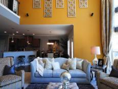 Yellow Living Room With High Ceilings