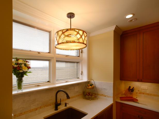Neutral Kitchen With Pendant Light Over Recessed Sink