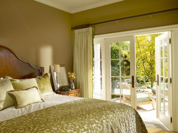 Yellow Bedroom With French Doors Onto Patio