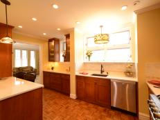 Transitional Kitchen With Wood Cabinets and Parquet Floors