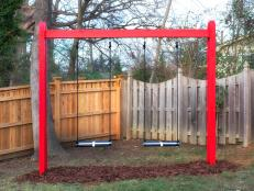 Red, Black and White Swing Set in Yard