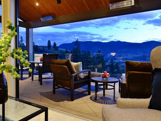 Living Room Open to a Deck With Furniture and View of the Mountains