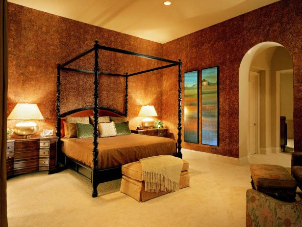 Master Bedroom With Black Canopy Bed and Red Patterned Wallpaper