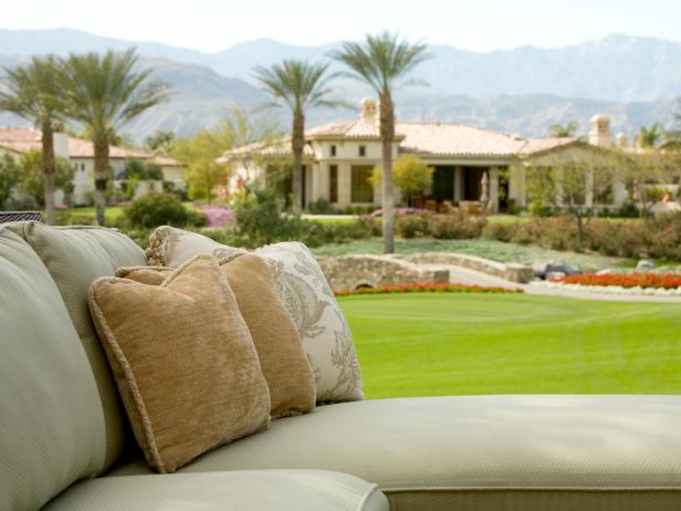 Sage Green Outdoor Sectional with Neutral Throw Pillows