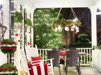 White Traditional Porch With Rocking Chairs and Holiday Decor
