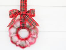 Frozen Holiday Wreath With Plaid Ribbon