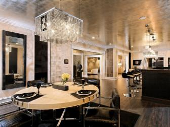 Black and White Dining Area With Crystal Chandelier