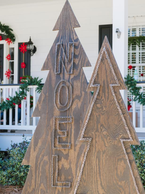 Make a rustic and modern statement in your front yard with Christmas tree silhouettes made from plywood and nail heads.