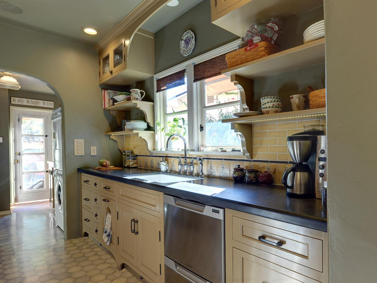 Mediterranean kitchen with open shelving this Moroccan inspired kitchen design