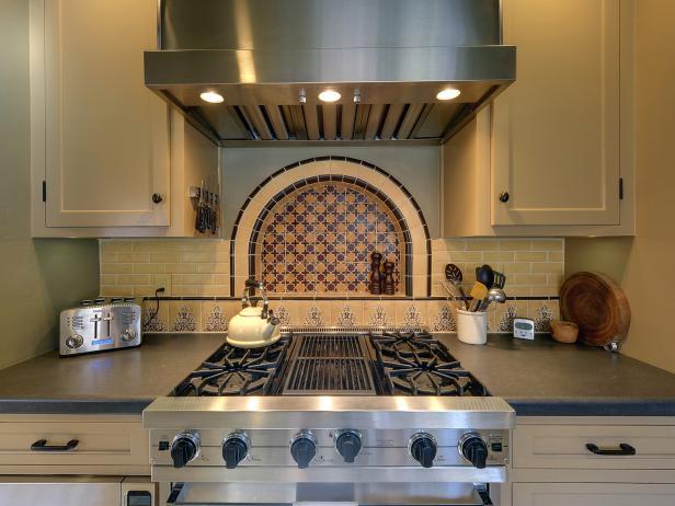 Stainless Steel Range With Beige and Burgundy Moroccan Tile Backsplash