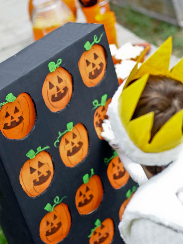 This kids' party game is easy to make and fun to play. You can make it simple by allowing kids to pick a prize depending on which pumpkin they choose or more difficult by making the object to match two items behind the pumpkin flaps.