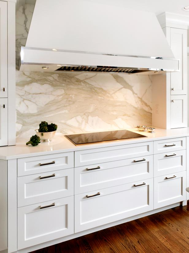 Contemporary White Kitchen Cabinets with Marble Backsplash