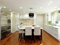 White Contemporary Kitchen With Eat-In Island