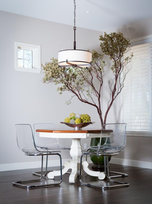 Dining Room With Two-Tone Pedestal Table, Lucite Chairs, Potted Tree