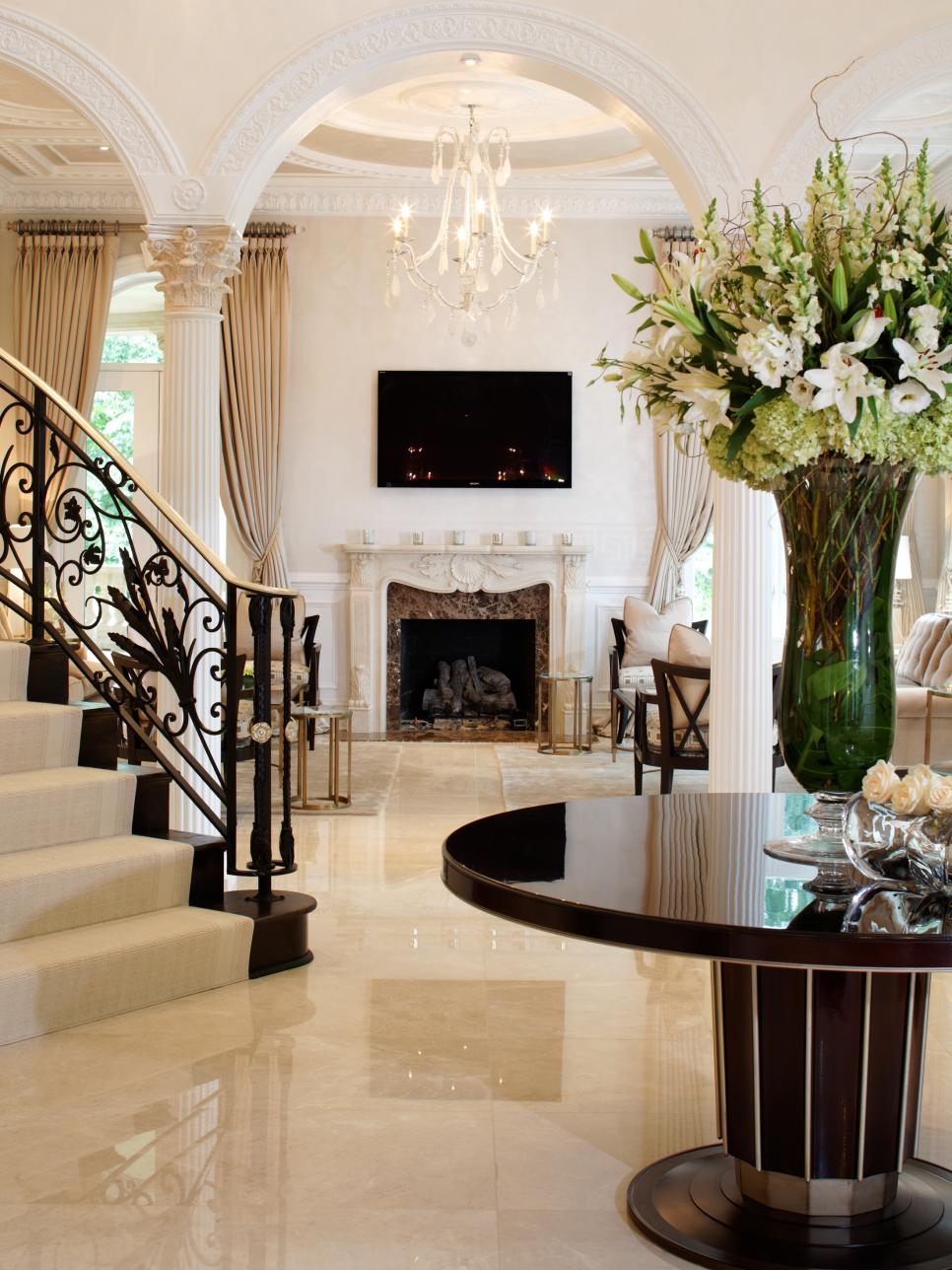 Elegant black and white entryway dahlia mahmood hgtv for Elegant foyer ideas