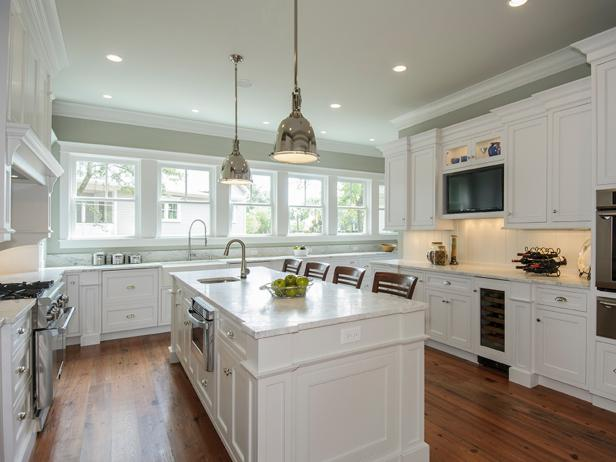 Traditional White Kitchen With Large Center Island and Hardwood Floors
