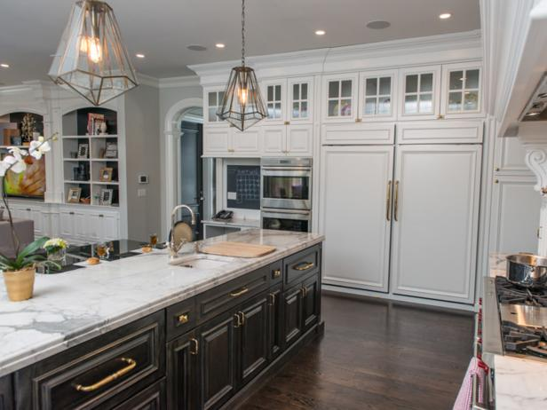 White Kitchen With Black Island Cabinets, White Countertops and Pantry