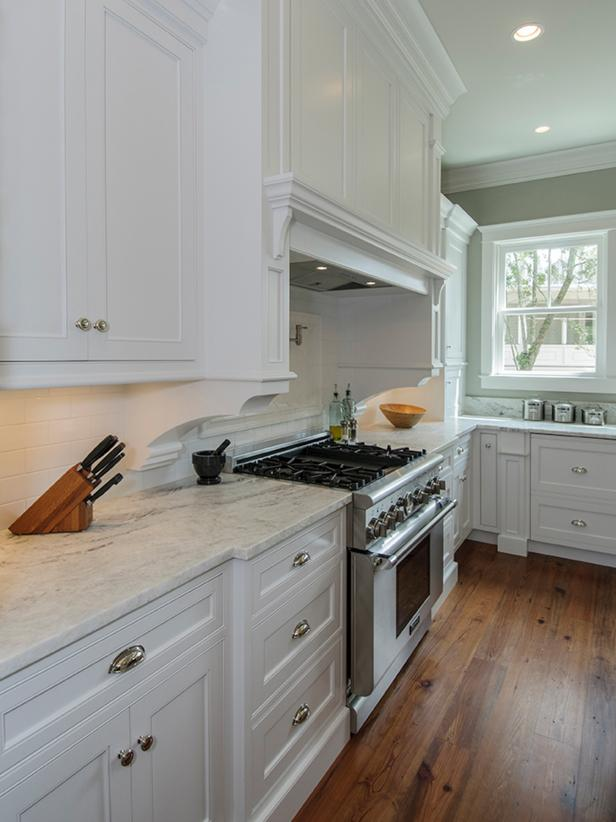 Traditional Kitchen With White Cabinetry and Marble Countertops