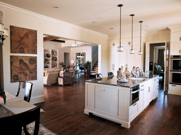 Neutral Kitchen With Large Island, Hardwood Floor & Pendants Lights