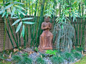 Asian Style Garden Featuring Buddha Surrounded by Bamboo