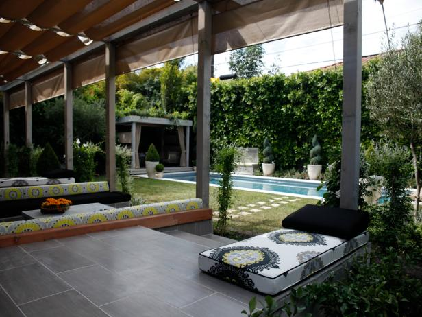 Covered Patio With Benches and Swimming Pool