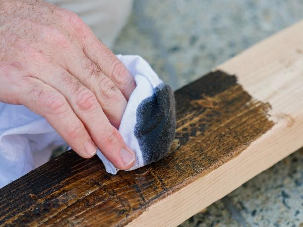 Rub a dark stain onto scrap wood pieces to make them look richer and more polished in the finished project.
