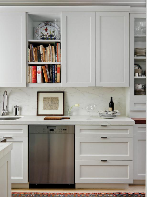 Kitchen With Tall White Cabinets, Built-In Shelves & Marble Backsplash