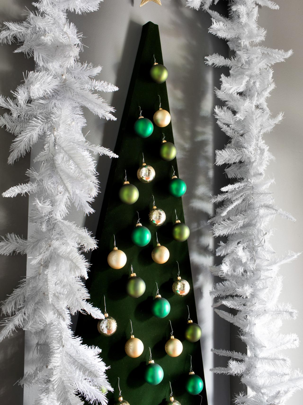 How to make a wall mounted christmas tree alternative hgtv How to hang garland on a christmas tree