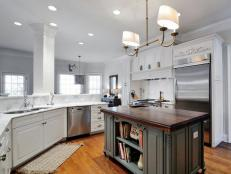 White Traditional Kitchen with Gray Island