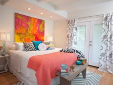 Cheery Master Bedroom with Chevron Rug and Bright Painting Above Bed